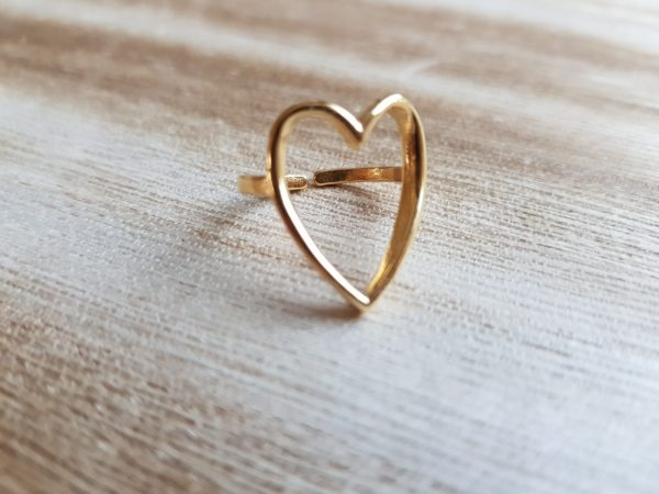 bague en acier doré coeur en or